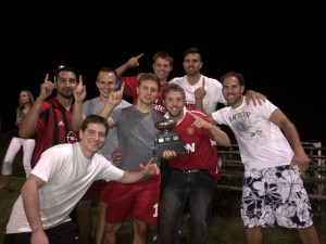 Players from Exports celebrate the League Championship, won under ridiculously nail-biting circumstances