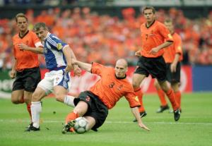 25 Jun 2000:  Jaap Stam (3) of Holland slides in to tackle Vladimir Jugovic of Yugoslavia during the European Championships 2000 quarter-final at the De Kuip Stadium in Rotterdam, Holland.  Holland won the match 6-1.  Photo Credit: Gary M Prior/Allsport
